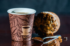 Work place coffee break with Muffin. Styrofoam coffee cup with black coffee and tea spoon with powder banana nut Muffin pastry Stock Images