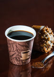 Work place coffee break with Muffin. Styrofoam coffee cup with black coffee and tea spoon with powder banana nut Muffin pastry Stock Photos