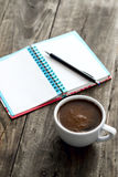 Work place with coffee and notepad Royalty Free Stock Photo