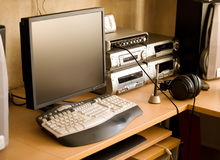 Work place with computer and audio equipment. Soft morning light Royalty Free Stock Photography