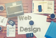 Work place concept - Office Desk with Tools and Notes About Web. Design with the beautiful dispersing sun light royalty free stock photos