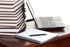 Work place laptop, pen, notebook on a table royalty free stock photography