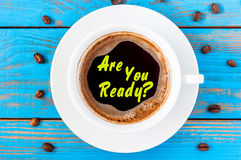 Work place with morning mug of coffee and motivate text - Are you ready stock images