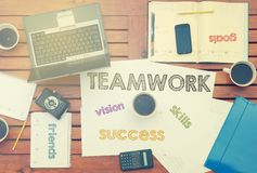 Work place with notebook with note about: Teamwork with laptop a Stock Photo
