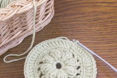 Work place with Vines basket and handmade crochet doily, coaster and a hook. Cotton yarn for knitting. Stock Photography