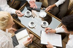 Work planning. Above view of confident businesspeople planning work in the room Royalty Free Stock Images