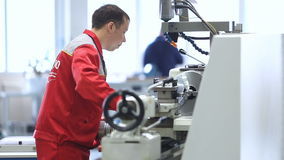 Work on the plant at the machine. Worker at a machine. work on the plant at the machine stock video footage