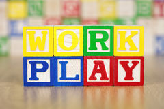 Work Play Spelled Out in Alphabet Building Blocks Royalty Free Stock Images