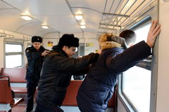 The work of the police arrest violators of public order on the train. Royalty Free Stock Images