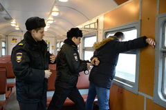 The work of the police arrest violators of public order on the train. Stock Photography
