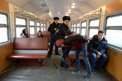 The work of the police detention of violators of public order on the train. Royalty Free Stock Photography