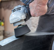 Work with polished granite grinder Royalty Free Stock Photos