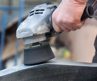 Work with polished granite grinder Royalty Free Stock Image