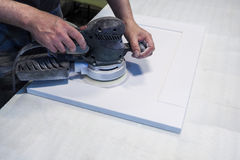 Work polishes parts furniture parts MDF, preparation before painting. Royalty Free Stock Photo