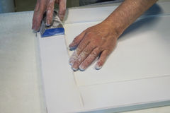 Work polishes parts furniture parts MDF, preparation before painting. Stock Photography