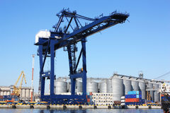 Work in the port. Loader containers; powerful, very big, new technology, container terminal Royalty Free Stock Image