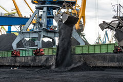 Work in port coal handling terminal. Royalty Free Stock Image