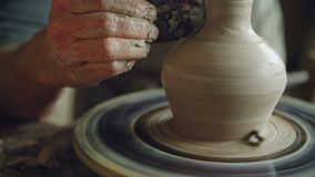 Work in pottery workshop: clay ware on throwing wheel, master ceramist molding clay using tools. Creating ceramic. Work in pottery workshop: clay ware on stock video footage