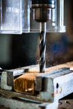 Work with power drill in workshop of carpenter Stock Photography
