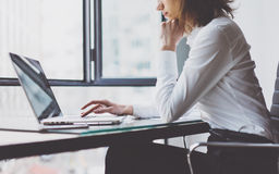 Work Process in Modern Office. Young Woman Account Manager Working at Wood Table with New Business Project. Typing. Working Process in Modern Office. Young Woman Royalty Free Stock Image