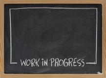 Work in progress on blackboard stock photography