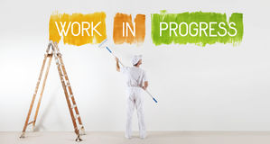 Work in progress concept, painter man with paint roller, isolated Royalty Free Stock Image