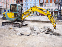 Work in progress with an excavator Royalty Free Stock Images
