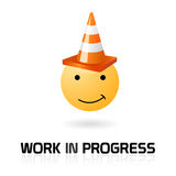 Work in progress funny symbol. A smile with work in progress road cone and text on blank Royalty Free Stock Image