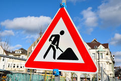 Work in progress road sign triangle  isolated on cloudy background Royalty Free Stock Photography
