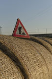 Work in progress roadsign over straw round bales Royalty Free Stock Photography