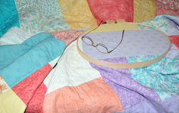 Work in Progress. A scrap quilt in the process of being hand quilted stock image