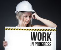 Work in progress sign on information board, thinking worker Royalty Free Stock Photo