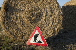 Work in progress sign with straw bales Royalty Free Stock Images