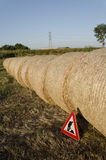 Work in progress sign with straw round bales Royalty Free Stock Photo