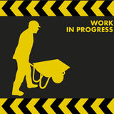 WORK IN PROGRESS sign with worker carries a wheelbarrow. WORK IN PROGRESS sign with construction worker silhouette carries a wheelbarrow Royalty Free Stock Photo