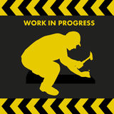 WORK IN PROGRESS sign with worker silhouette Royalty Free Stock Photo