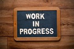 Work in progress written in English Royalty Free Stock Photo