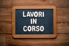 Work in progress written in Italian Royalty Free Stock Photos