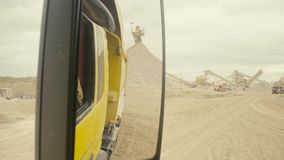 The work in the quarry shooting from the truck. The work in the quarry shooting through the truck window stock video footage