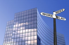 Work Rest & Play business sign Stock Photo