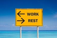WORK or REST sign. On sea background Royalty Free Stock Photos