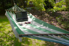 Work and rest. In summer – laptop, sunglasses and phone on hammock Royalty Free Stock Images