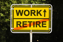 WORK and RETIRE. Blue sky behind a yellow city limit or place name sign informing with an arrow that you are on the way to work and leaving retire Stock Images