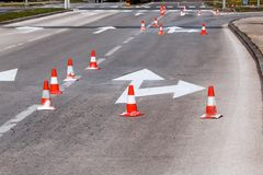 Work on the road, street signs and road marking. Work on the road. Street signs and road marking. Traffic signs for signaling. Road maintenance, under Royalty Free Stock Image