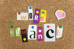 WORK ROMANCE. Single letters pinned on cork noticeboard Stock Photos