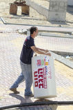 Work Roni Sassi with a solar water heater -Mitzpe Ramon, Israel. Middle East- Mitzpe Ramon, Israel. February 29,The installation of new solar water heaters royalty free stock photo