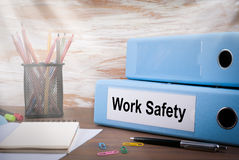 Work Safety, Office Binder on Wooden Desk. On the table colored pencils, pen, notebook paper.  Stock Image