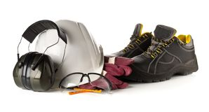 Work safety and protection equipment - protective shoes, safety glasses, gloves and hearing protection over white royalty free stock photos