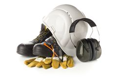 Work safety and protection equipment - protective shoes, safety glasses, gloves and hearing protection. Over white background royalty free stock images