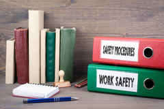 Work Safety and Safety Procedures. Binders on desk in the office. Business background Royalty Free Stock Images